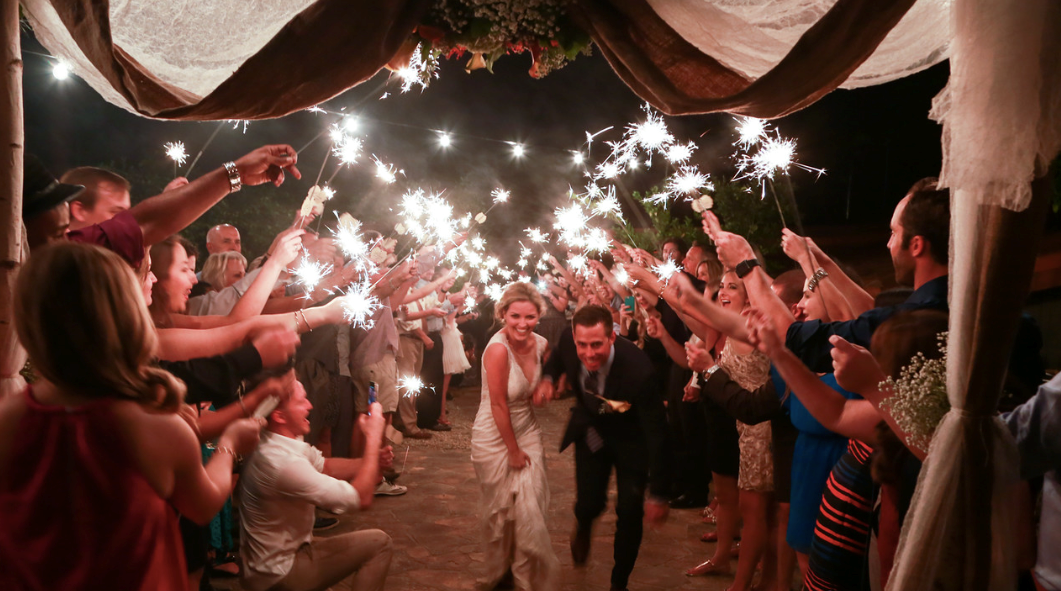 create one of the most dramatic exits by giving all of your guests wedding day sparklers to hold aloft as you walk out together arm in arm